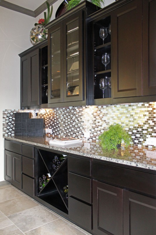 Burrows Cabinets' kitchen cabinets in Beech Rye with Briscoe doors and big x wine rack