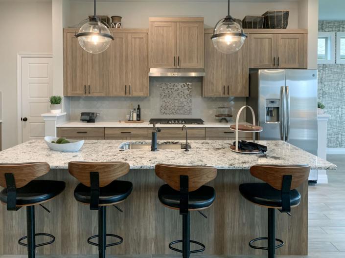 Modern frameless EVRGRN kitchen in warm woodgrain