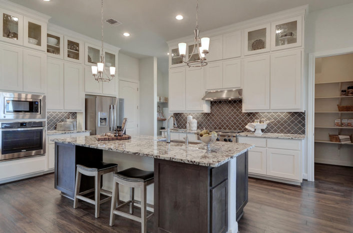 Kitchen with Shaker doors in Bone white and Knotty Alder with Driftwood stain by Burrows Cabinets