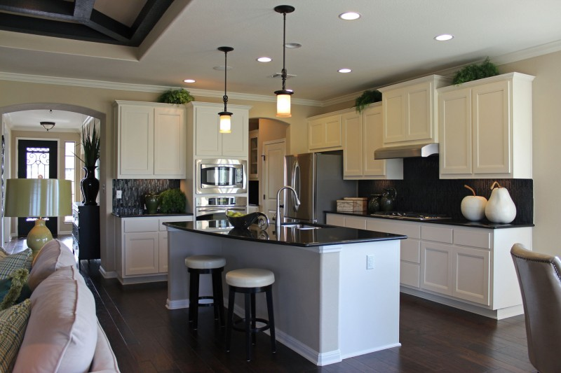 Burrows Cabinets white kitchen cabinets with Briscoe design in Bone and custom wood vent hood