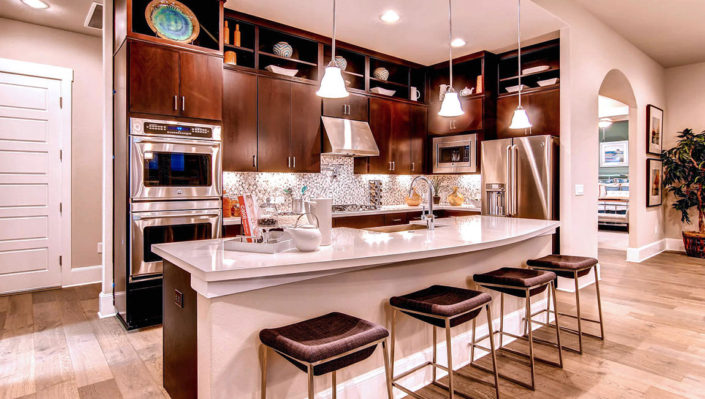 Kitchen with modern slab doors in Alder by Burrows Cabinets