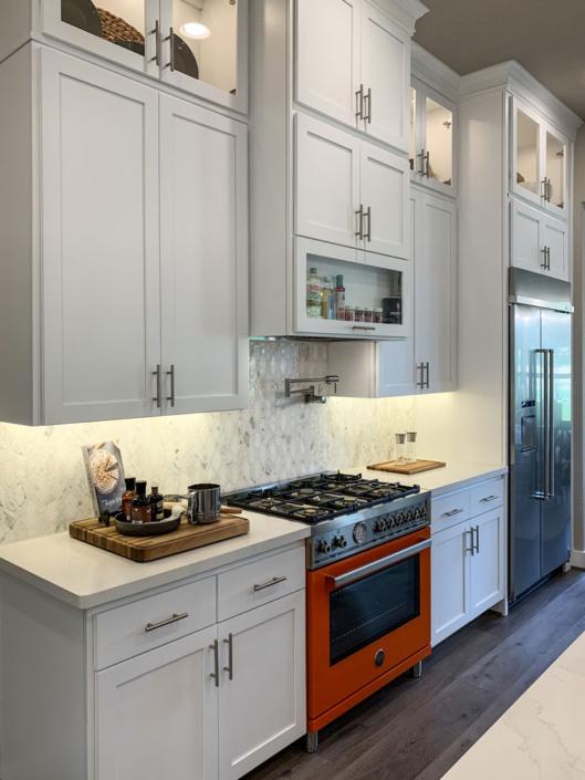 white kitchen shaker doors orange oven
