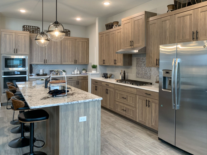 Kitchen in EVRGRN woodgrain with 5-Pc doors