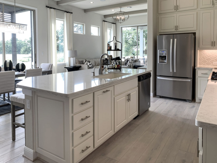 Kitchen island with trash pull out, bank of 4 drawers and end panel