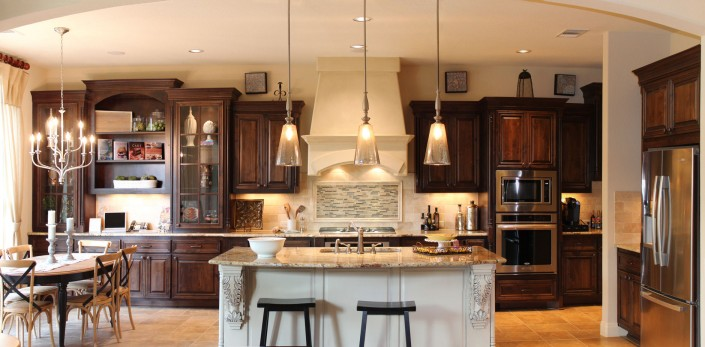 Burrows Cabinets' kitchen cabinets in stained knotty alder and island in bone white