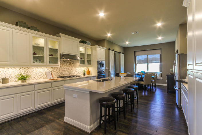 Burrows Cabinets' bone white kitchen with raised panel doors and glass inserts