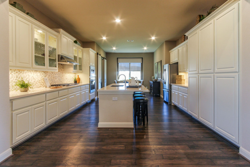 Burrows Cabinets' Bone white kitchen with raised panel doors