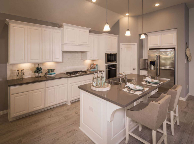 Burrows Cabinets' kitchen in Frost with corbels on island