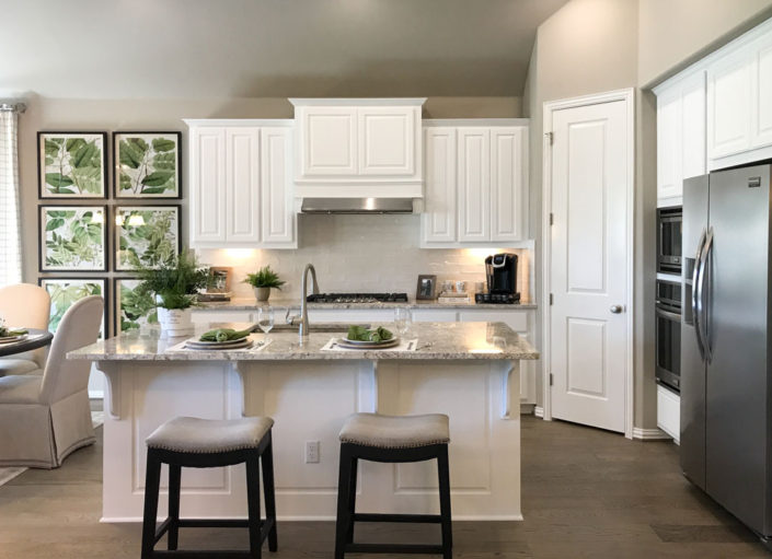 Burrows Cabinets' kitchen cabinets with raised panel doors in Frost white