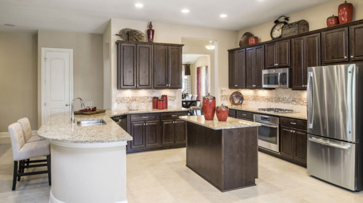 Burrows Cabinets raised panel kitchen cabinets in Knotty Alder Kona