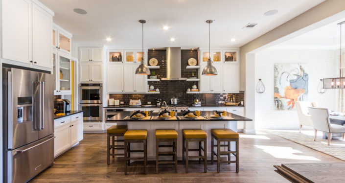 Burrows Cabinets' kitchen with Shaker doors in Bone white, floating shelves and glass uppers