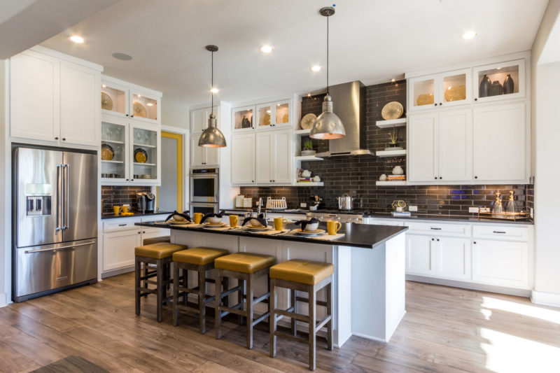 Burrows Cabinets' kitchen with Shaker doors in Bone white and floating shelves