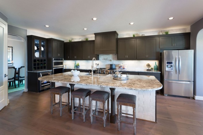Burrows Cabinets gray kitchen with Shaker style doors and built-in wine rack