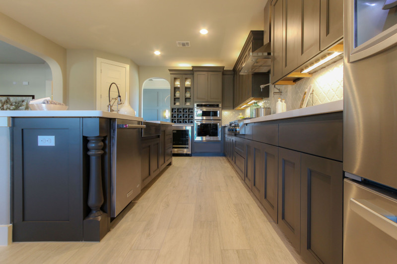 Burrows Cabinets' kitchen in Umber with Terrazzo doors and Monaco posts