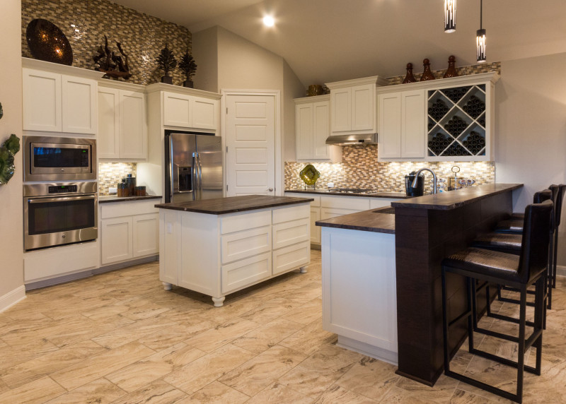 Burrows Cabinets' white kitchen with Big X wine rack and bunn feet on island