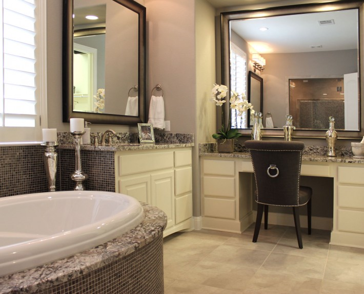 Burrows Cabinets' master bathroom with makeup vanity in bone white