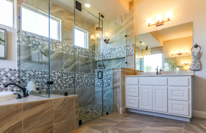 Burrows Cabinets' master bath in Bone with raised panel doors