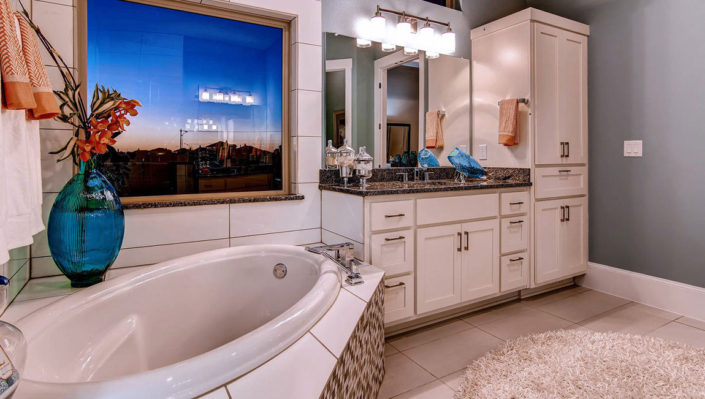 Master bath with white shaker cabinets by Burrows Cabinets