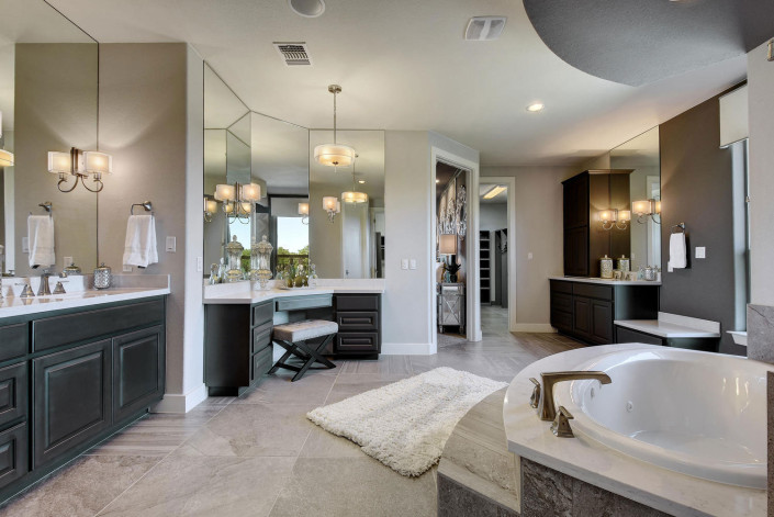 Burrows Cabinets' bathroom cabinets in Umber with knee space makeup vanity
