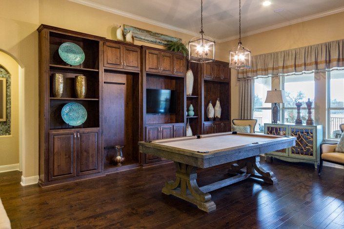 Burrows Cabinets' game room media center cabinets in Alder with raised panel doors