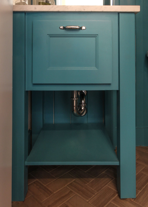 Burrows Cabinets' modern vanity in custom turquoise paint