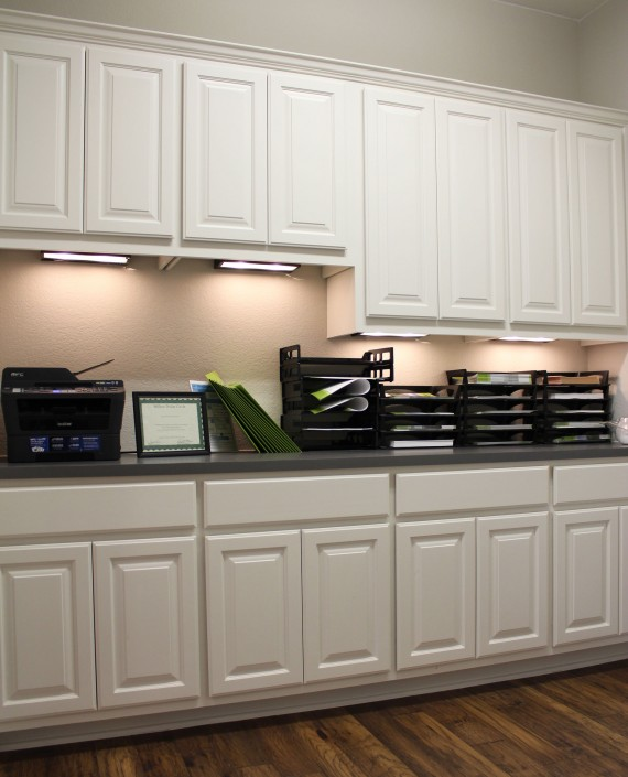 Burrows Cabinets office wall cabinets with undermount lighting