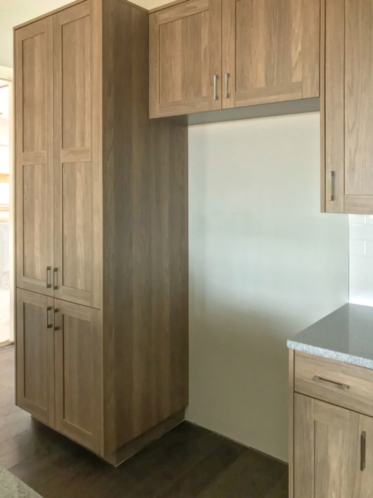 Tall EVRGRN cabinet with 5-piece doors