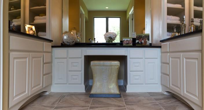 Burrows Cabinets' master bath vanity with raised panel doors in Bone