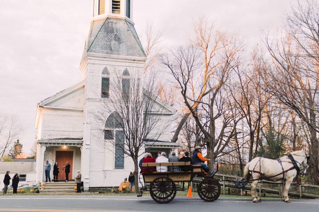 Guests arriving by horse and carriage in Vernon Center