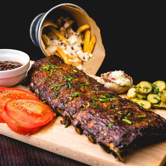 Ribs on board with sides