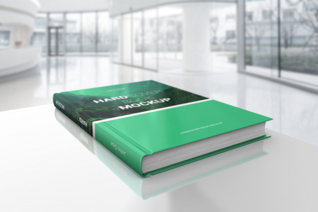 Hardcover Book on White Table