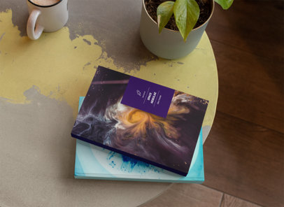 Books on Table with a Plant