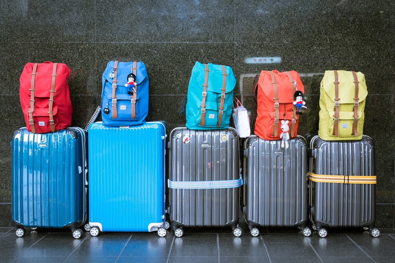 row of suitcases and book bags