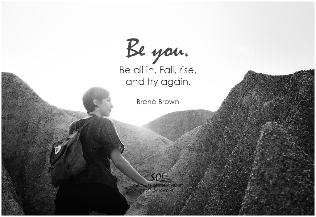 Young woman by large boulders looking to the side. On top is a Brene Brown quote that says: Be you, be all in. Fall, rise, and try again.