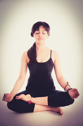 Women in meditation pose