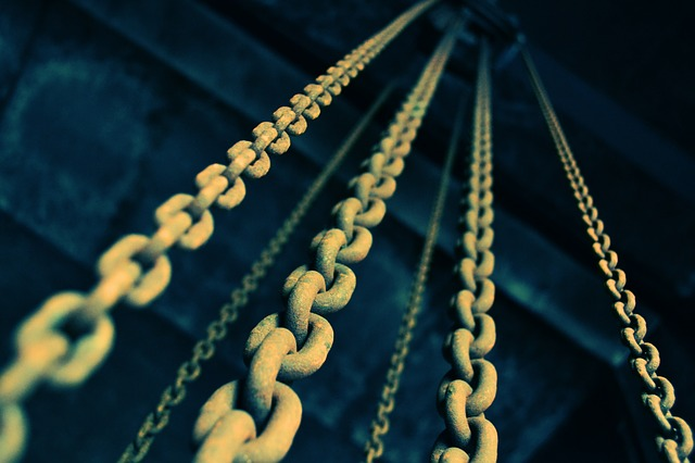 Picture of strong chains holding probably an elevator