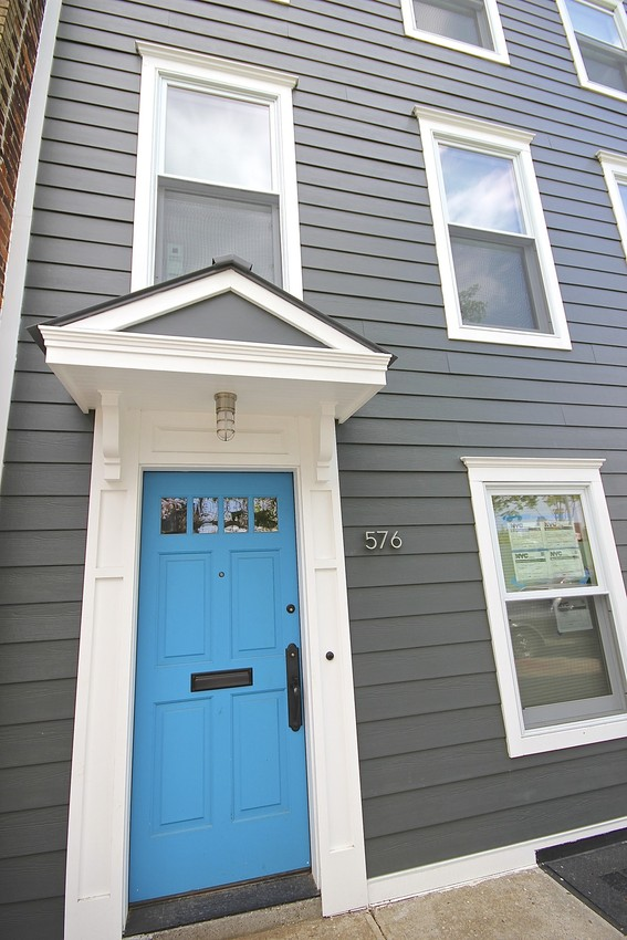 HardiePhotos Submission: contractor_name: Premier Building and Renovations comments: This James Hardie Siding project took place in Brooklyn, NY. The color choice of this project was James Hardie's Iron Gray. Every window was replaced and a beautiful blue door was added to make this Brooklyn home really stand out. The owners were very happy with there newly renovated Brooklyn home. products: HardiePlank, HardieTrim, HardieSoffit colors: Arctic White, Iron Gray