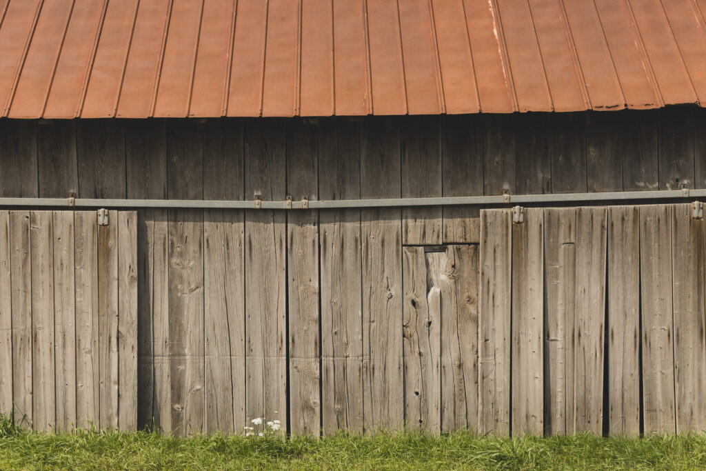 The wooden siding and roof of a Vermont barn.