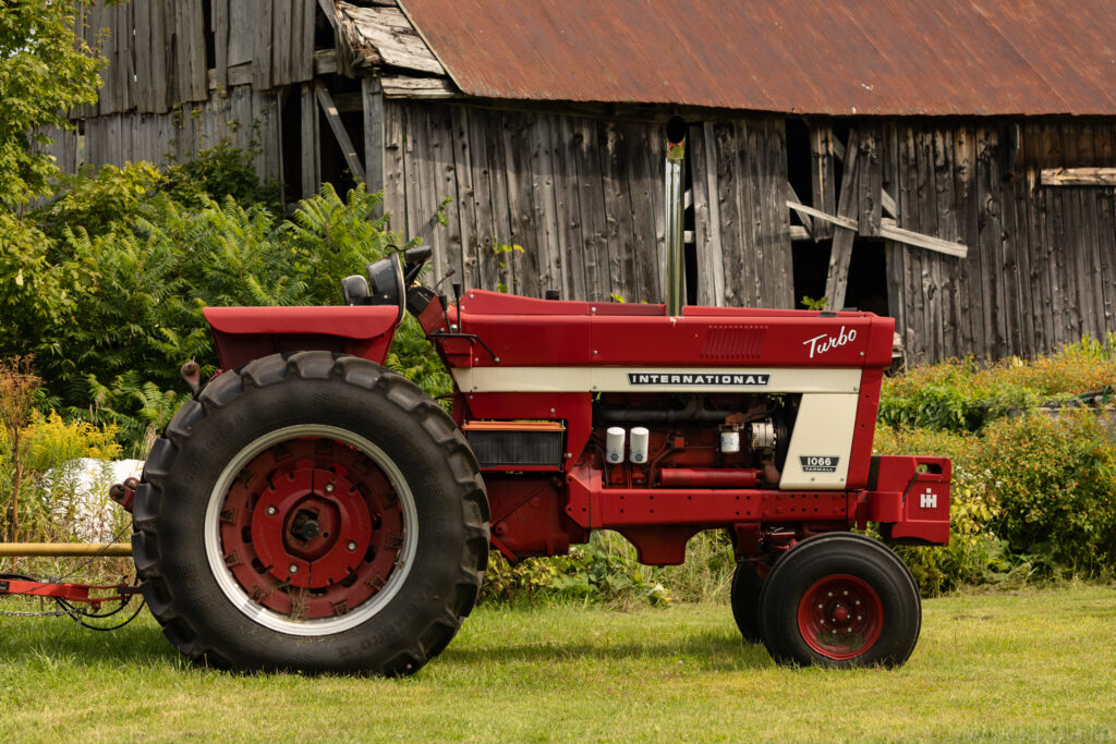An International Tractor parked near a barn in Vermont.