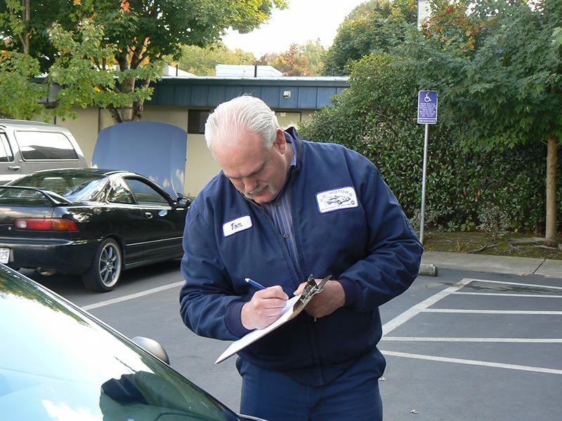 Mechanic in Tualatin writing an auto repair work order.