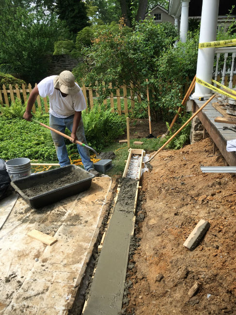 Pouring New Footer for Stairs during a Porch Remodel by John Neill Painting