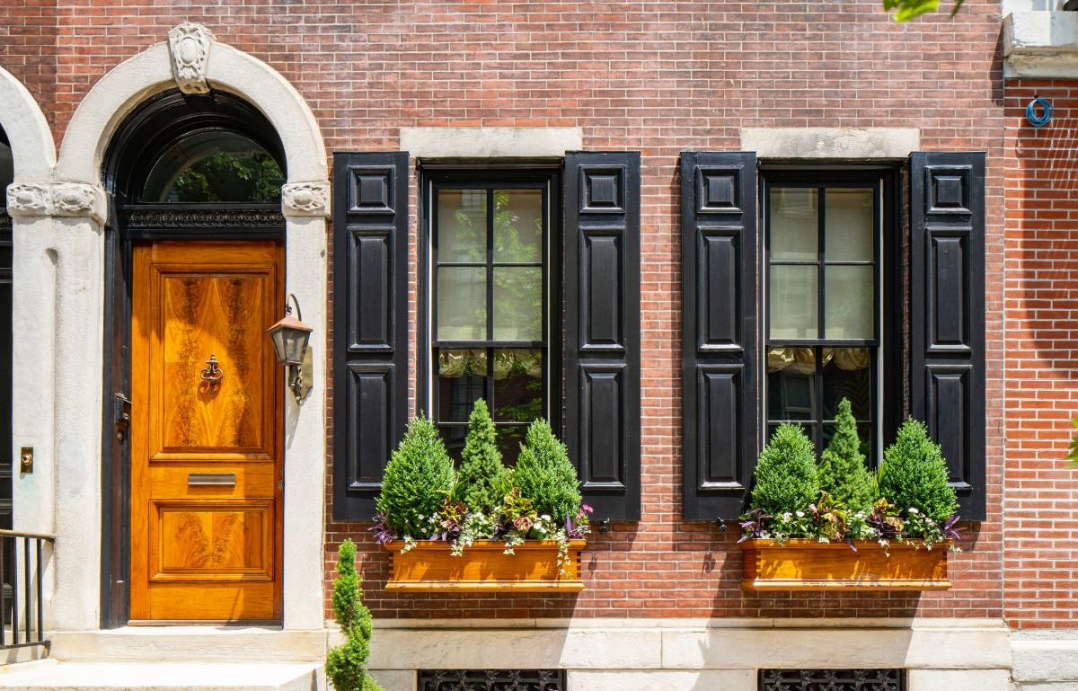 Center city townhouse with wood grained door and shutters