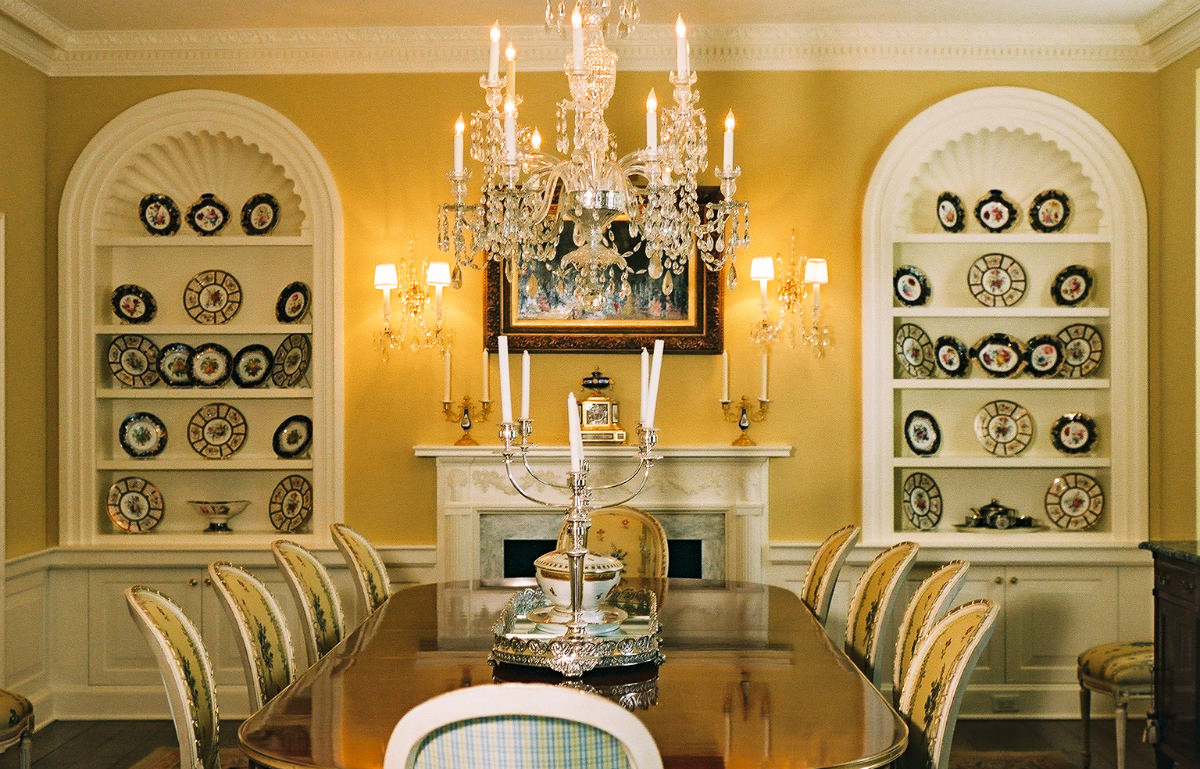 Formal dining room with yellow walls and built in cabinets by John Neill Painting and Decorating of Philadelphia