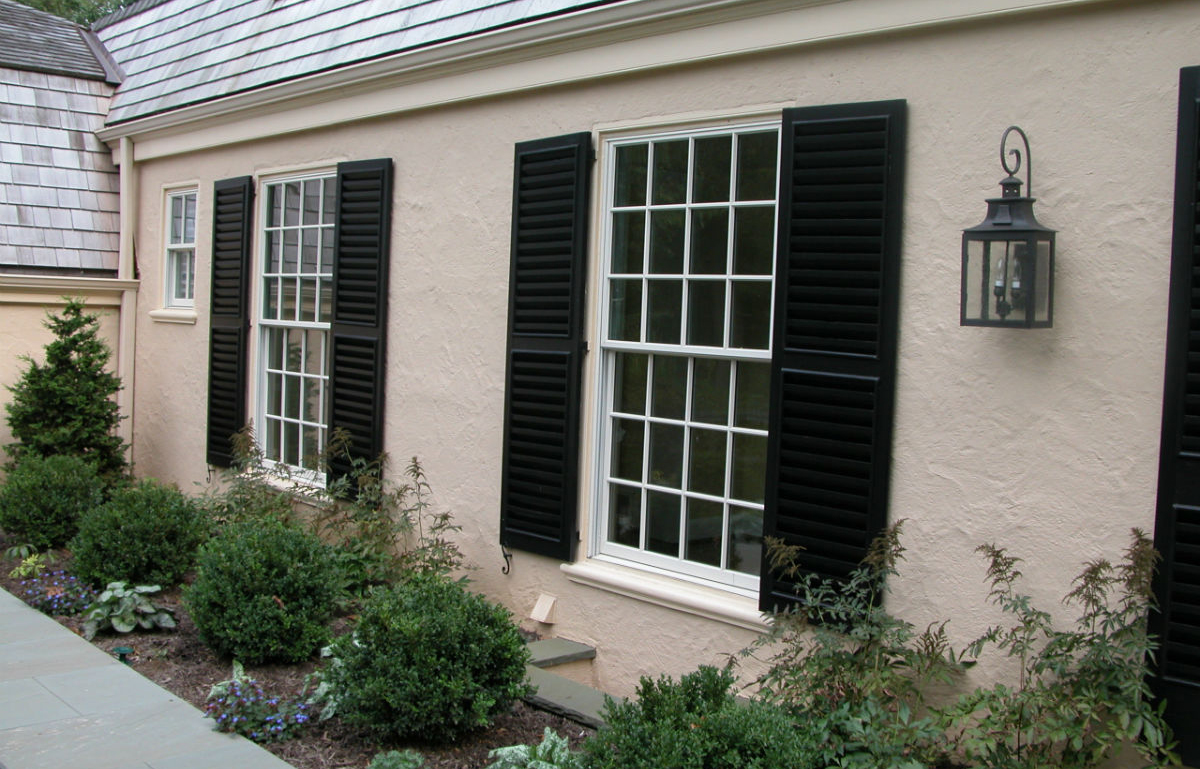 Beautiful stucco work with black accent shutters by John Neill Painting of Philadelphia.