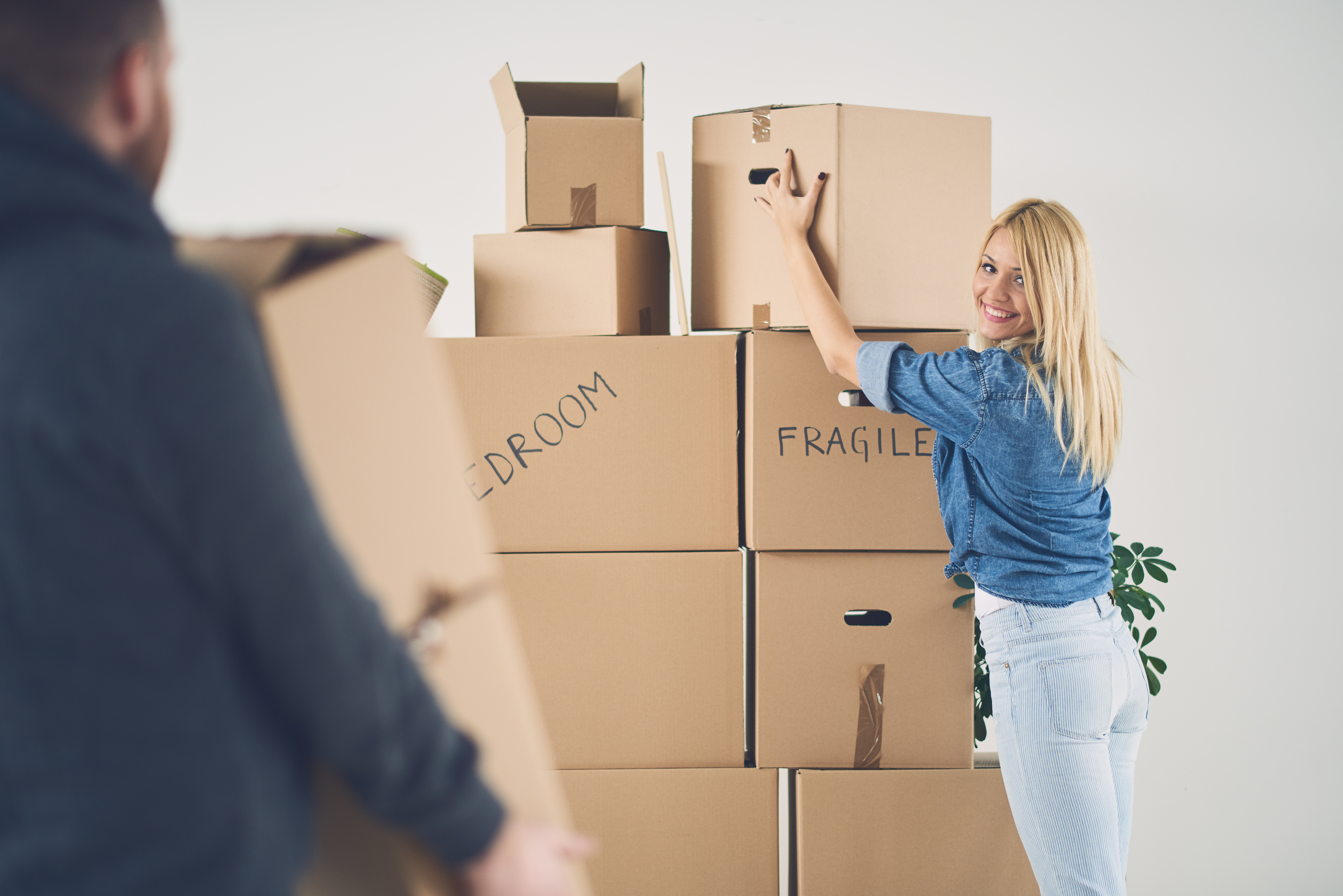couple in new apartment with many boxes