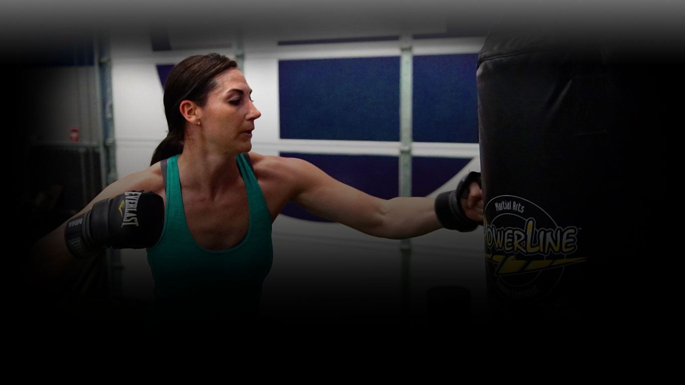 woman exercising with boxing glove