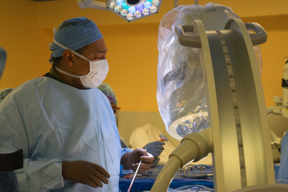 Dr. Braxton performing spine surgery