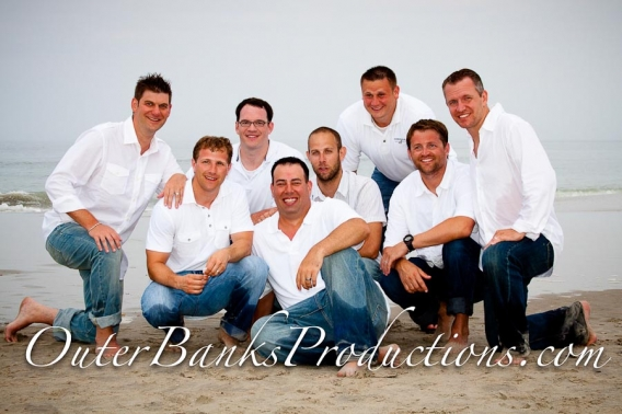 Family portrait with jeans and white shirts.