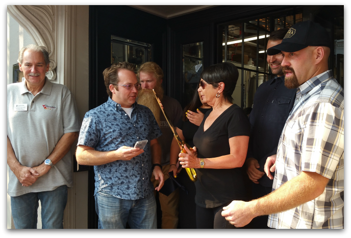 Loma Brewing Company Grand Opening - Scott Youkilis and Kevin Youkilis, owners, hold the ribbon while Barbara Spector, mayor of Los Gatos, does the cutting.