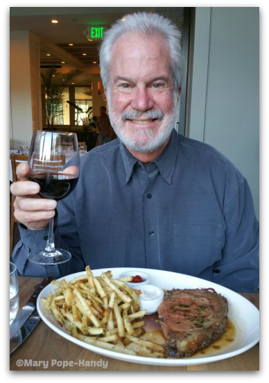 Jim Handy with small prime rib and fries with truffle oil at the Catamount